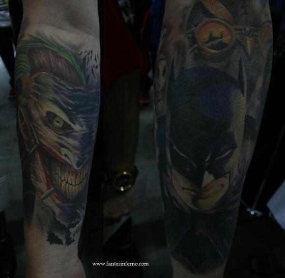 Batfan Joe shows off his tattoo in progress of the Joker (front) and Batman (back).